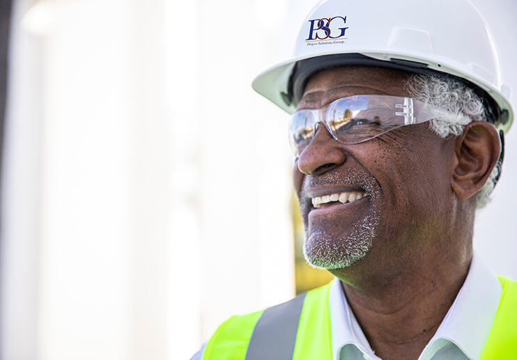 Canva Smiling Construction Worker